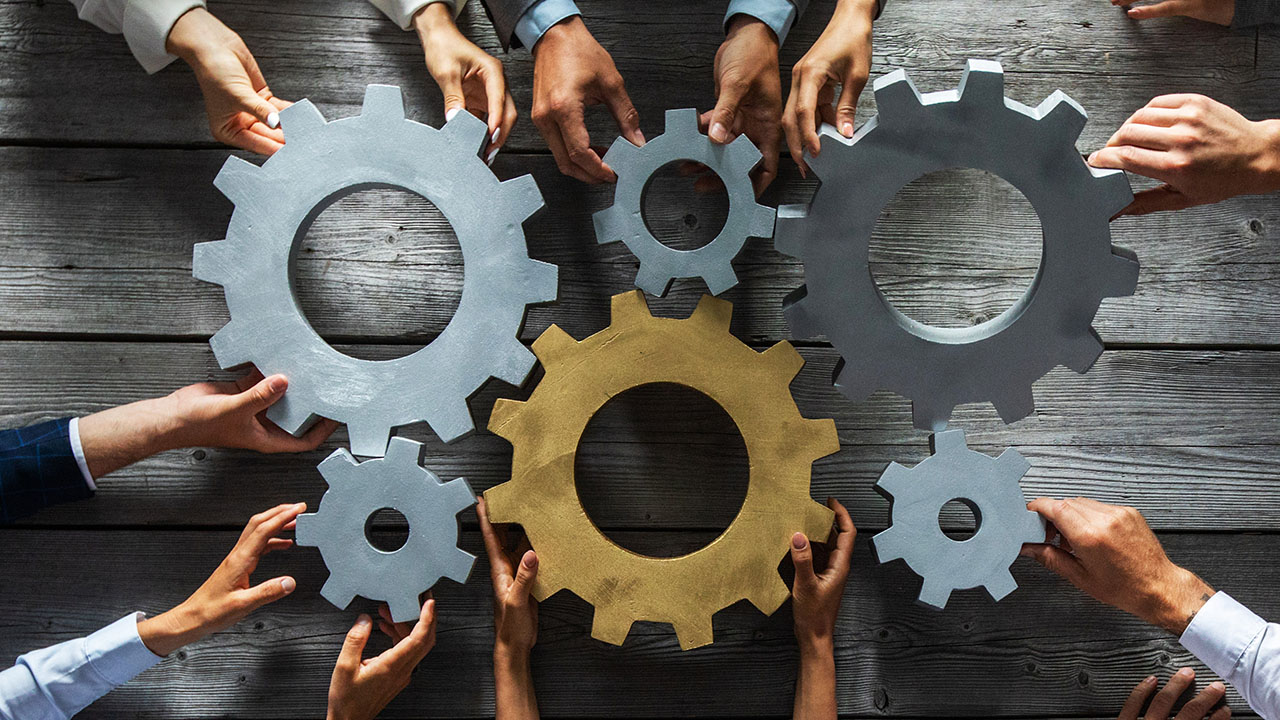 Image of a Scrum team working together in an agile business